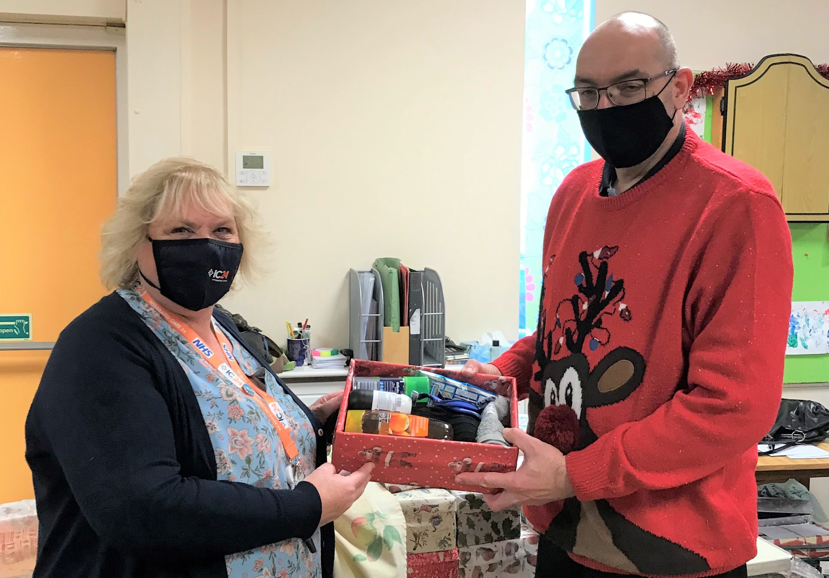 Eastbourne Station Health Centre team donates Christmas funds to The Salvation Army - IC24